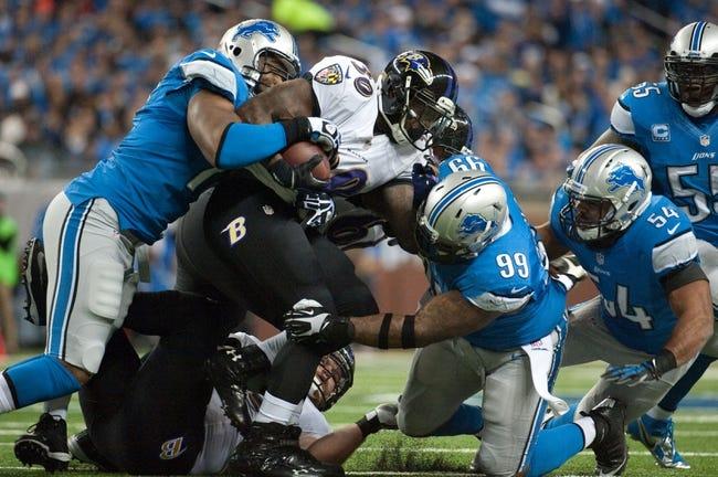 Dec 16, 2013; Detroit, MI, USA; Detroit Lions defensive tackle C.J. Mosley (99) tackles Baltimore Ravens running back Bernard Pierce (30) during the game at Ford Field. Mandatory Credit: Tim Fuller-USA TODAY Sports
