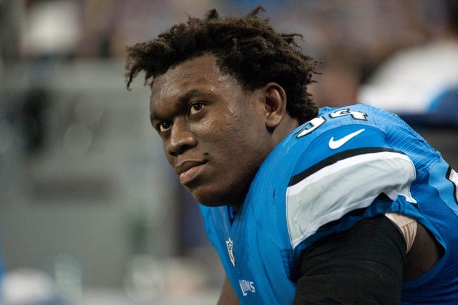 Dec 16, 2013; Detroit, MI, USA; Detroit Lions defensive end Ezekiel Ansah (94) during the game against the Baltimore Ravens at Ford Field. Mandatory Credit: Tim Fuller-USA TODAY Sports