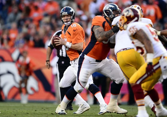 Oct 27, 2013; Denver, CO, USA; Denver Broncos quarterback Peyton Manning (18) prepares to pass in the fourth quarter against the Washington Redskins at Sports Authority Field at Mile High. Mandatory Credit: Ron Chenoy-USA TODAY Sports