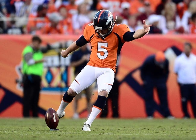Oct 27, 2013; Denver, CO, USA; Denver Broncos kicker Matt Prater (5) kicks off in the third quarter against the Washington Redskins at Sports Authority Field at Mile High. Mandatory Credit: Ron Chenoy-USA TODAY Sports