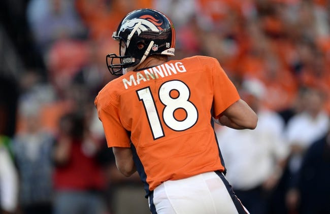 Oct 27, 2013; Denver, CO, USA; Denver Broncos quarterback Peyton Manning (18) prepares to pass in the third quarter against the Washington Redskins at Sports Authority Field at Mile High. Mandatory Credit: Ron Chenoy-USA TODAY Sports