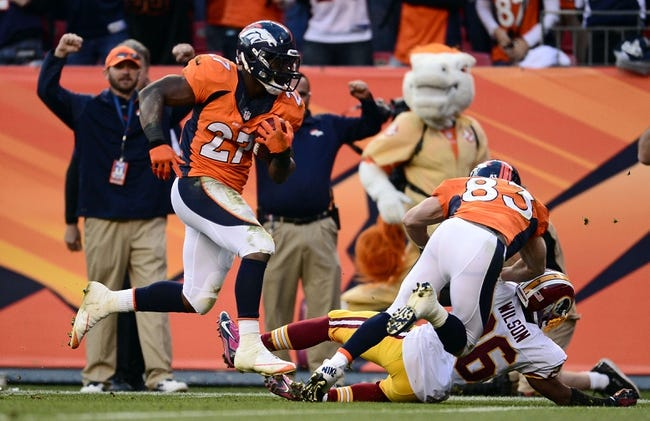 Oct 27, 2013; Denver, CO, USA; Denver Broncos running back Knowshon Moreno (27) scores on thirty five yard touchdown pass as Denver Broncos wide receiver Wes Welker (83) blocks on Washington Redskins cornerback Josh Wilson (26) in the fourth quarter at Sports Authority Field at Mile High. Mandatory Credit: Ron Chenoy-USA TODAY Sports