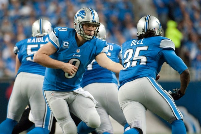 Dec 16, 2013; Detroit, MI, USA; Detroit Lions quarterback Matthew Stafford (9) hands off to running back Joique Bell (35) during the game against the Baltimore Ravens at Ford Field. Mandatory Credit: Tim Fuller-USA TODAY Sports
