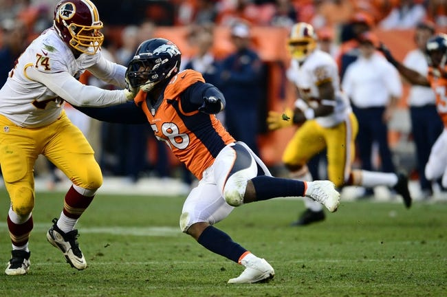 Oct 27, 2013; Denver, CO, USA; Washington Redskins tackle Tyler Polumbus (74) pass protects on Denver Broncos outside linebacker Von Miller (58) in the fourth quarter at Sports Authority Field at Mile High. Mandatory Credit: Ron Chenoy-USA TODAY Sports