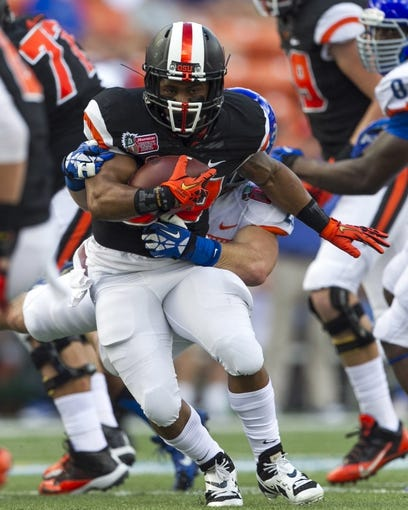 Dec 24, 2013; Honolulu, HI, USA; Oregon State Beavers running back Terron Ward (28) breaks away from Boise State Broncos linebacker Tanner Vallejo (20) at the 2013 Hawaii Bowl at Aloha Stadium. Mandatory Credit: Marco Garcia-USA TODAY Sports