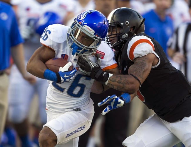 Dec 24, 2013; Honolulu, HI, USA; Boise State Broncos running back Devan Demas (26) is tackled by Oregon State Beavers safety Tyrequek Zimmerman (8) during the 2013 Hawaii Bowl at Aloha Stadium. Mandatory Credit: Marco Garcia-USA TODAY Sports