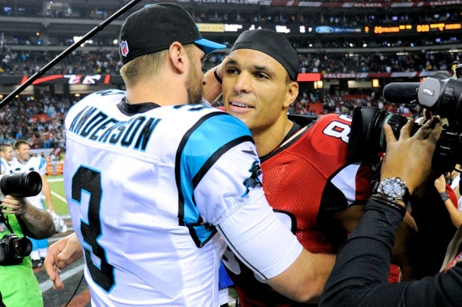 Dec 29, 2013; Atlanta, GA, USA; Carolina Panthers quarterback Derek Anderson (3) hugs Atlanta Falcons tight end Tony Gonzalez (88) after the game at the Georgia Dome. The Panthers won 21-20. Mandatory Credit: Dale Zanine-USA TODAY Sports