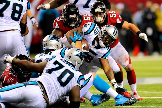 Dec 29, 2013; Atlanta, GA, USA; Carolina Panthers fullback Mike Tolbert (35) fights for yardage against the Atlanta Falcons during the second half at the Georgia Dome. The Panthers defeated the Falcons 21-20. Mandatory Credit: Dale Zanine-USA TODAY Sports