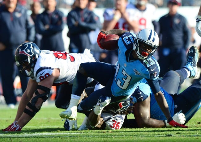 Dec 29, 2013; Nashville, TN, USA; Tennessee Titans wide receiver Kendall Wright (13) is tackled by Houston Texans safety D. J. Swearinger (36) during the second half at LP Field. The Titans won 16-10. Mandatory Credit: Don McPeak-USA TODAY Sports