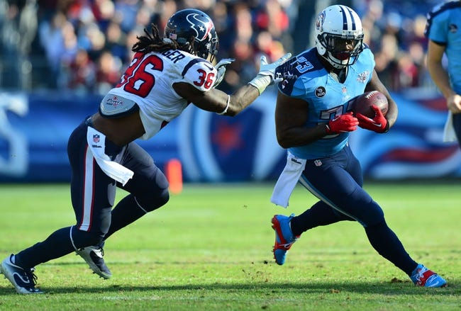 Dec 29, 2013; Nashville, TN, USA; Tennessee Titans running back Shonn Greene (23) carries the ball as Houston Texans safety D.J. Swearinger (36) chases during the second half at LP Field. The Titans won 16-10. Mandatory Credit: Don McPeak-USA TODAY Sports