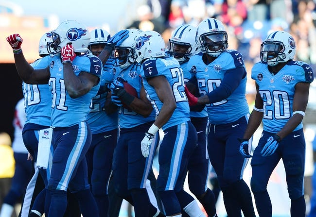 Dec 29, 2013; Nashville, TN, USA; Tennessee Titans safety Michael Griffin (33) celebrates with teammates after making an interception against the Houston Texans during the second half at LP Field. The Titans won 16-10. Mandatory Credit: Don McPeak-USA TODAY Sports