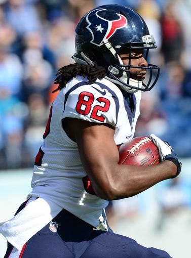 Dec 29, 2013; Nashville, TN, USA; Houston Texans wide receiver Keshawn Martin (82) runs with the ball against the Tennessee Titans during the first half at LP Field. The Titans won 16-10. Mandatory Credit: Don McPeak-USA TODAY Sports