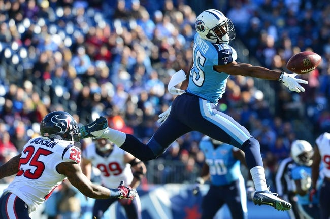 Dec 29, 2013; Nashville, TN, USA; Tennessee Titans wide receiver Justin Hunter (15) reaches for a pass against the Houston Texans during the first half at LP Field. The Titans won 16-10. Mandatory Credit: Don McPeak-USA TODAY Sports