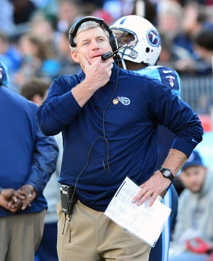 Dec 29, 2013; Nashville, TN, USA; Tennessee Titans head coach Mike Munchak looks at the scoreboard against the Houston Texans during the second half at LP Field. The Titans won 16-10. Mandatory Credit: Don McPeak-USA TODAY Sports