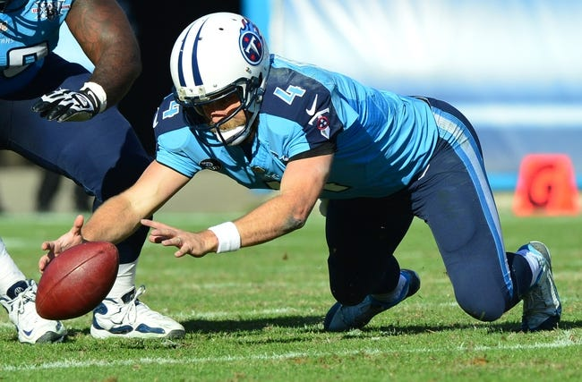 Dec 29, 2013; Nashville, TN, USA; Tennessee Titans quarterback Ryan Fitzpatrick (4) grabs a fumble against the Houston Texans during the second half at LP Field. The Titans won 16-10. Mandatory Credit: Don McPeak-USA TODAY Sports