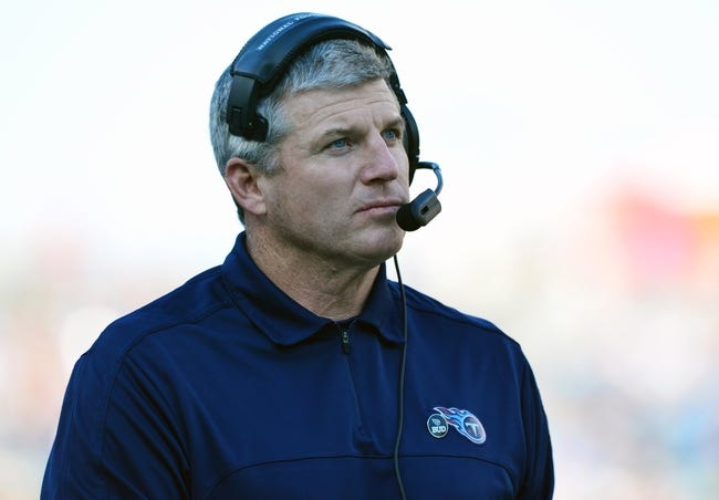 Dec 29, 2013; Nashville, TN, USA; Tennessee Titans head coach Mike Munchak watches from the sidelines against the Houston Texans during the second half at LP Field. The Titans won 16-10. Mandatory Credit: Don McPeak-USA TODAY Sports