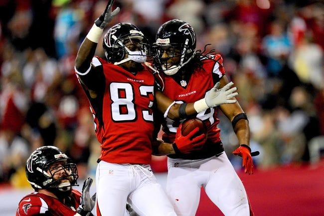 Dec 29, 2013; Atlanta, GA, USA; Atlanta Falcons wide receiver Roddy White (84) celebrates with wide receiver Harry Douglas (83) after catching a touchdown pass against the Carolina Panthers during the second half at the Georgia Dome. The Panthers defeated the Falcons 21-20. Mandatory Credit: Dale Zanine-USA TODAY Sports