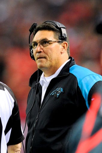 Dec 29, 2013; Atlanta, GA, USA; Carolina Panthers head coach Ron Rivera watches the scoreboard against the Atlanta Falcons during the first half at the Georgia Dome. The Panthers defeated the Falcons 21-20. Mandatory Credit: Dale Zanine-USA TODAY Sports