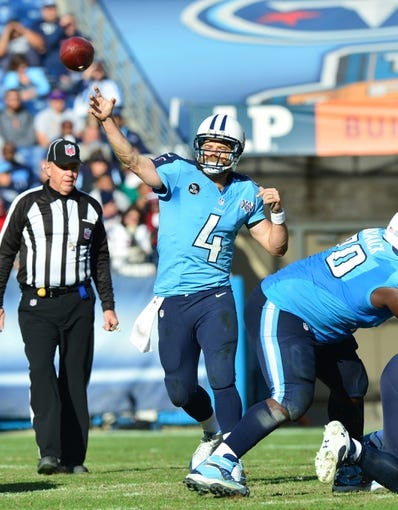 Dec 29, 2013; Nashville, TN, USA; Tennessee Titans quarterback Ryan Fitzpatrick (4) passes against the Houston Texans during the second half at LP Field. The Titans beat the Texans 16-10. Mandatory Credit: Don McPeak-USA TODAY Sports