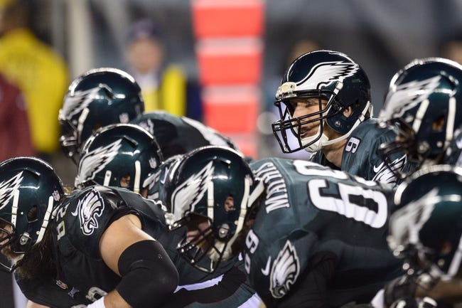 Dec 22, 2013; Philadelphia, PA, USA; Philadelphia Eagles quarterback Nick Foles (9) under center during the second quarter against the Chicago Bears at Lincoln Financial Field. The Eagles defeated the Bears 54-11. Mandatory Credit: Howard Smith-USA TODAY Sports