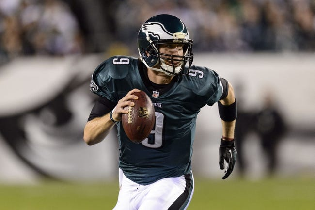 Dec 22, 2013; Philadelphia, PA, USA; Philadelphia Eagles quarterback Nick Foles (9) rolls out during the first quarter against the Chicago Bears at Lincoln Financial Field. The Eagles defeated the Bears 54-11. Mandatory Credit: Howard Smith-USA TODAY Sports