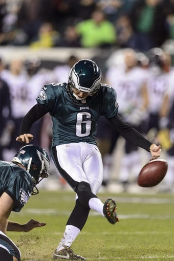 Dec 22, 2013; Philadelphia, PA, USA; Philadelphia Eagles kicker Alex Henery (6) kicks a PAT during the fourth quarter against the Chicago Bears at Lincoln Financial Field. The Eagles defeated the Bears 54-11. Mandatory Credit: Howard Smith-USA TODAY Sports