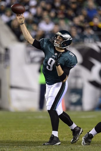 Dec 22, 2013; Philadelphia, PA, USA; Philadelphia Eagles quarterback Nick Foles (9) passes the ball during the third quarter against the Chicago Bears at Lincoln Financial Field. The Eagles defeated the Bears 54-11. Mandatory Credit: Howard Smith-USA TODAY Sports