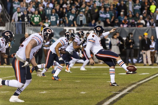 Dec 22, 2013; Philadelphia, PA, USA; Chicago Bears punter Adam Podlesh (8) has a free kick after safety during the third quarter against the Philadelphia Eagles at Lincoln Financial Field. The Eagles defeated the Bears 54-11. Mandatory Credit: Howard Smith-USA TODAY Sports