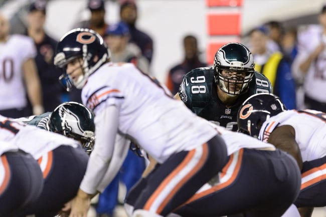Dec 22, 2013; Philadelphia, PA, USA; Philadelphia Eagles linebacker Connor Barwin (98) keeps his eyes on Chicago Bears quarterback Jay Cutler (6) during the fourth quarter at Lincoln Financial Field. The Eagles defeated the Bears 54-11. Mandatory Credit: Howard Smith-USA TODAY Sports