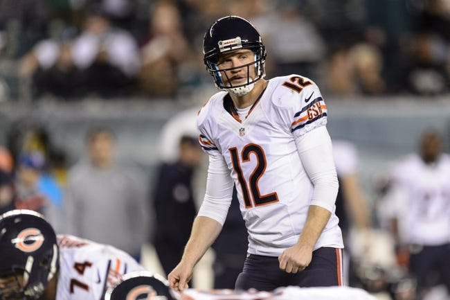 Dec 22, 2013; Philadelphia, PA, USA; Chicago Bears quarterback Josh McCown (12) gets set during the fourth quarter against the Philadelphia Eagles at Lincoln Financial Field. The Eagles defeated the Bears 54-11. Mandatory Credit: Howard Smith-USA TODAY Sports