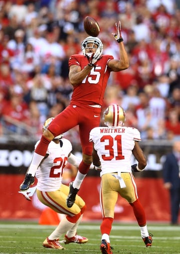 Dec 29, 2013; Phoenix, AZ, USA; Arizona Cardinals wide receiver Michael Floyd (15) catches a pass in the second half against the San Francisco 49ers at University of Phoenix Stadium. The 49ers defeated the Cardinals 23-20. Mandatory Credit: Mark J. Rebilas-USA TODAY Sports