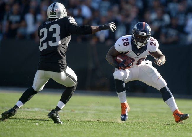 Dec 29, 2013; Oakland, CA, USA; Denver Broncos running back Montee Ball (28) runs with the ball as Oakland Raiders cornerback Tracy Porter (23) chases at O.co Coliseum. The Broncos won 34-14. Mandatory Credit: Kirby Lee-USA TODAY Sports