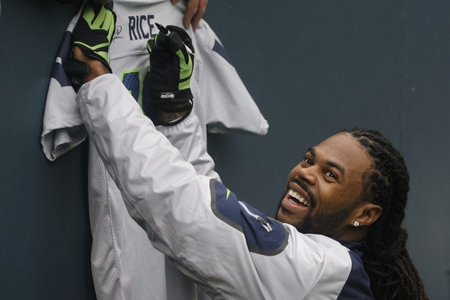 Dec 29, 2013; Seattle, WA, USA; Seattle Seahawks wide receiver Sidney Rice (18) signs a jersey prior to the game against the St. Louis Rams at CenturyLink Field. Mandatory Credit: Joe Nicholson-USA TODAY Sports