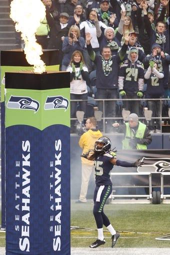 Dec 29, 2013; Seattle, WA, USA; Seattle Seahawks cornerback Richard Sherman (25) runs on to the field prior to the game against the St. Louis Rams at CenturyLink Field. Mandatory Credit: Joe Nicholson-USA TODAY Sports