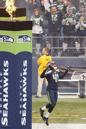Dec 29, 2013; Seattle, WA, USA; Seattle Seahawks cornerback Byron Maxwell (41) runs on to the field prior to the game against the St. Louis Rams at CenturyLink Field. Mandatory Credit: Joe Nicholson-USA TODAY Sports