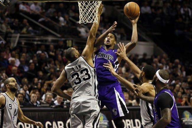Dec 29, 2013; San Antonio, TX, USA; Sacramento Kings forward Rudy Gay (8) puts up a shot over San Antonio Spurs forward Boris Diaw (33) during the second half at the AT&T Center. The Spurs won 112-104. Mandatory Credit: Soobum Im-USA TODAY Sports