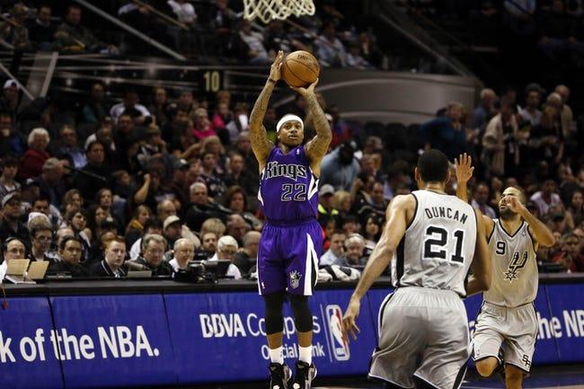 Dec 29, 2013; San Antonio, TX, USA; Sacramento Kings guard Isaiah Thomas (22) shoots during the second half against the San Antonio Spurs at the AT&T Center. The Spurs won 112-104. Mandatory Credit: Soobum Im-USA TODAY Sports