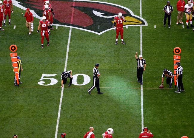 Dec 29, 2013; Phoenix, AZ, USA; Overall view as NFL officials use yard markers to measure distance for a first down during the game between the Arizona Cardinals against the San Francisco 49ers at University of Phoenix Stadium. The 49ers defeated the Cardinals 23-20. Mandatory Credit: Mark J. Rebilas-USA TODAY Sports