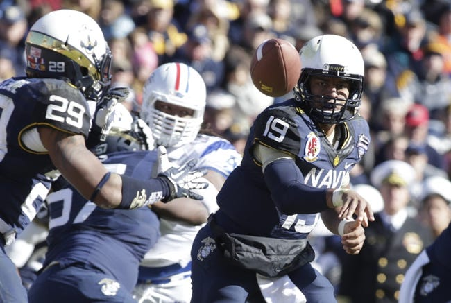 Dec 30, 2013; Fort Worth, TX, USA; Navy Midshipmen quarterback Keenan Reynolds (19) pitches the ball to running back Geoffrey Whiteside (29) in the fourth quarter of the game against the Middle Tennessee Blue Raiders  at Amon G. Carter Stadium. Mandatory Credit: Tim Heitman-USA TODAY Sports