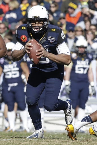 Dec 30, 2013; Fort Worth, TX, USA; Navy Midshipmen quarterback Tago Smith (18) runs the option against the Middle Tennessee Blue Raiders in the third quarter  at Amon G. Carter Stadium. Mandatory Credit: Tim Heitman-USA TODAY Sports