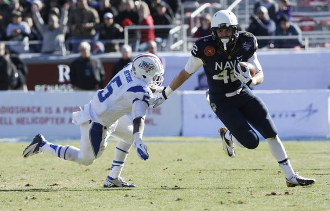 Dec 30, 2013; Fort Worth, TX, USA; Navy Midshipmen safety George Jamison (42) returns an interception against Middle Tennessee Blue Raiders running back Jeremiah Bryson (5) in the fourth quarter  at Amon G. Carter Stadium. Mandatory Credit: Tim Heitman-USA TODAY Sports