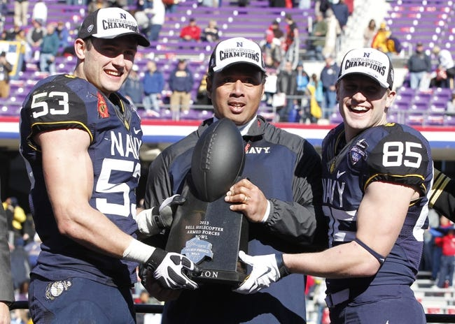 Dec 30, 2013; Fort Worth, TX, USA;  (L to R) Navy Midshipmen linebacker Cody Peterson (53) head coach Kenneth Niumatalolo and wide receiver Matt Aiken (85) hold the trophy after the game against the Middle Tennessee Blue Raiders at Amon G. Carter Stadium. Navy beat Middle Tennessee 24-6. Mandatory Credit: Tim Heitman-USA TODAY Sports