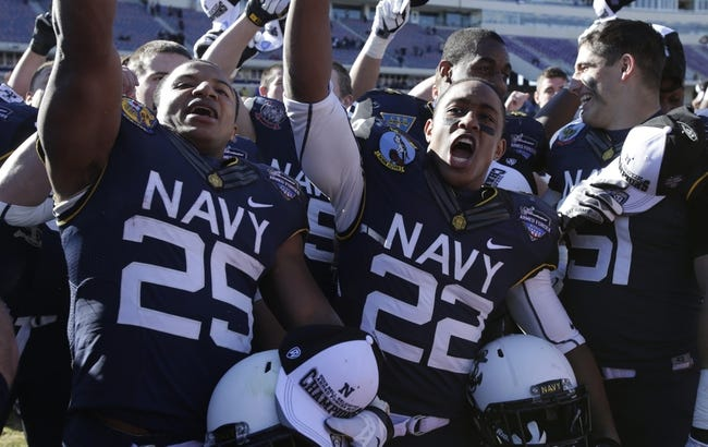 Dec 30, 2013; Fort Worth, TX, USA; Navy Midshipmen running back Demond Brown (25) and running back Toneo Gulley (22) celebrate after the game against the Middle Tennessee Blue Raiders at Amon G. Carter Stadium.  Navy beat Middle Tennessee 24-6. Mandatory Credit: Tim Heitman-USA TODAY Sports