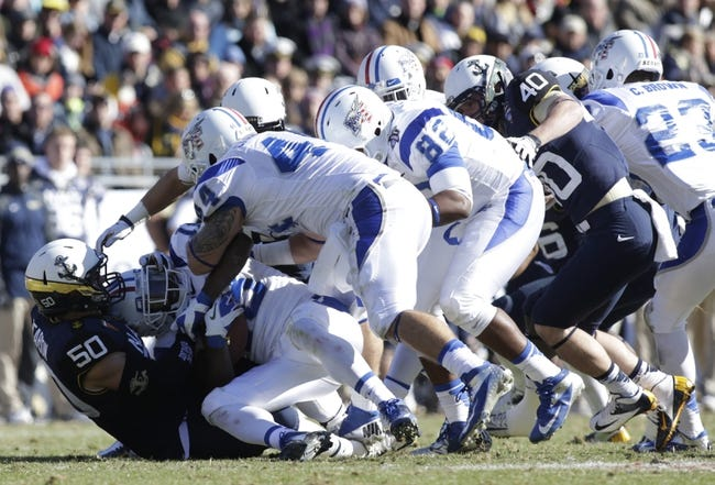 Dec 30, 2013; Fort Worth, TX, USA;  Middle Tennessee Blue Raiders kick returner Kenneth Gilstrap (18) is tackled by Middle Tennessee Blue Raiders linebacker Iman Smith (50) in the game at Amon G. Carter Stadium.  Navy beat Middle Tennessee 24-6. Mandatory Credit: Tim Heitman-USA TODAY Sports