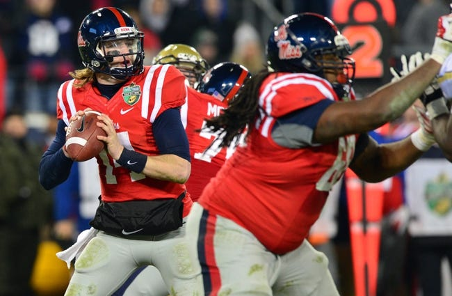 Dec 30, 2013; Nashville, TN, USA; Mississippi Rebels quarterback Bo Wallace (14) looks to throw against the Georgia Tech Yellow Jackets during the second half at LP Field. The Rebels beat the Yellow Jackets 25-17. Mandatory Credit: Don McPeak-USA TODAY Sports