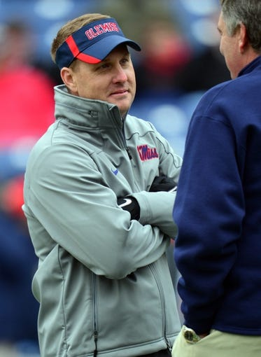 Dec 30, 2013; Nashville, TN, USA; Mississippi Rebels head coach Hugh Freeze talks with Georgia Tech Yellow Jackets head coach Paul Johnson before a game at LP Field. The Rebels beat the Yellow Jackets 25-17. Mandatory Credit: Don McPeak-USA TODAY Sports