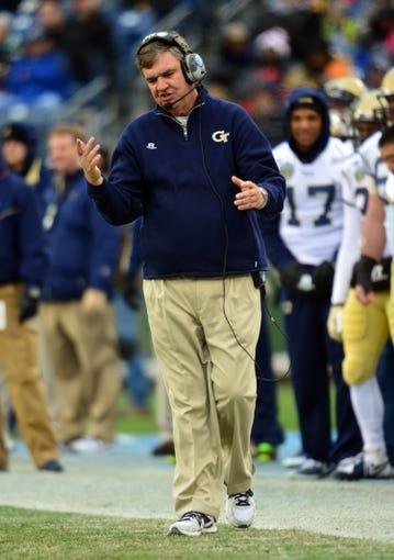 Dec 30, 2013; Nashville, TN, USA; Georgia Tech Yellow Jackets head coach Paul Johnson walks the sideline during a game against the Mississippi Rebels during the first half at LP Field. The Rebels beat the Yellow Jackets 25-17. Mandatory Credit: Don McPeak-USA TODAY Sports