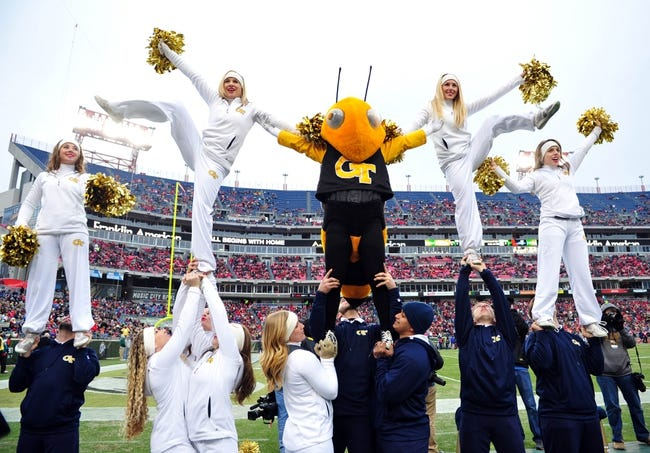 Dec 30, 2013; Nashville, TN, USA; Georgia Tech Yellow Jackets cheerleaders perform in a game against the Mississippi Rebels during the first half at LP Field. The Rebels beat the Yellow Jackets 25-17. Mandatory Credit: Don McPeak-USA TODAY Sports