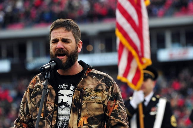 Dec 30, 2013; Nashville, TN, USA; Country Music personality Craig Campbell sings God Bless America before a game between the Mississippi Rebels and the Georgia Tech Yellow Jackets at LP Field. The Rebels beat the Yellow Jackets 25-17. Mandatory Credit: Don McPeak-USA TODAY Sports