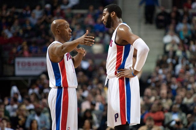 Dec 30, 2013; Auburn Hills, MI, USA; Detroit Pistons shooting guard Chauncey Billups (left) talks to center Andre Drummond (right) during the third quarter against the Washington Wizards at The Palace of Auburn Hills. Washington won 106-99. Mandatory Credit: Tim Fuller-USA TODAY Sports